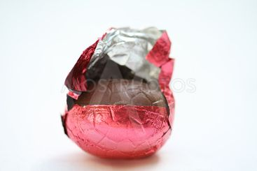 Chocolate easter egg in red wrapping