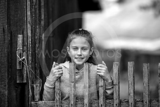 Rural teen girl, black and white portrait outdoors.