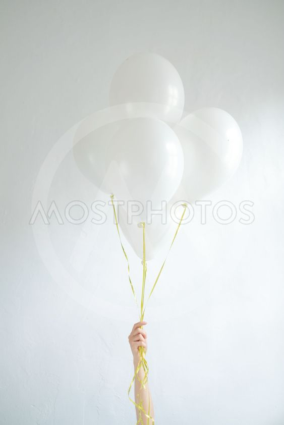 Hand hold blank white balloon mock up isolated