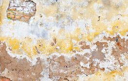 grunge cracked brick stucco wall background