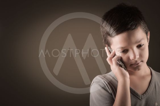 Studio Shot Of French Boy With Mobile Phone
