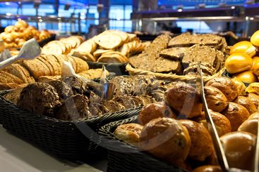 Rolls and Sliced Bread in Baskets on Buffet