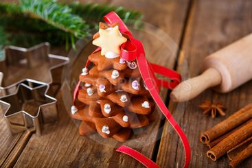 Homemade baked Christmas gingerbread tree on vintage...