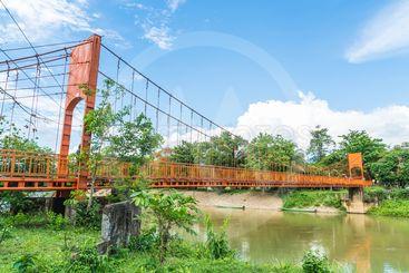 Orange bridge cross the river at Jung cave in Vang Vieng,
