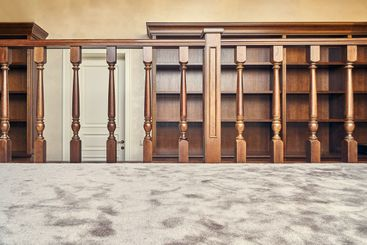 Wooden bookcase with empty shelves and a wooden...