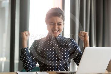 Happy overjoyed indian business woman winner celebrate...