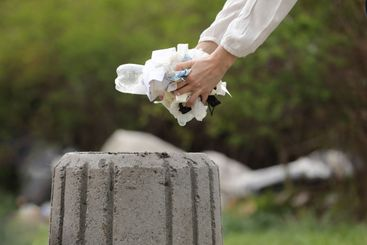 woman throws plastic garbage in the trash. woman hand...