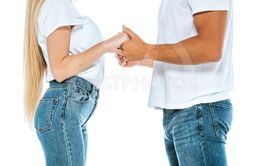cropped view of man and woman holding hands isolated on...