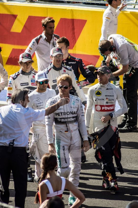 The pilots of formula one gathered together on the...