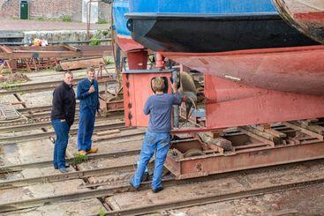 Workers repairing rudder ship at shipyard in Dutch...