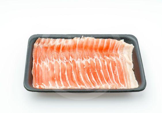 Slide of  raw pork  on white background .