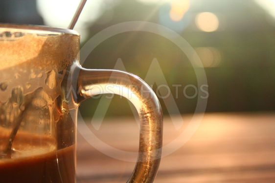 Morning coffee in the light of the rising sun.