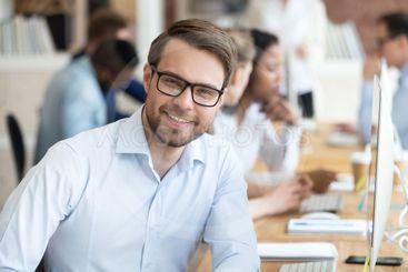 Head shot portrait confident smiling millennial businessman