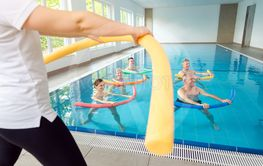 People in aqua fitness class during a physical therapy...