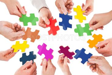 Business People Holding Colorful Jigsaw Pieces