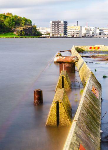 Concrete pier protruding into a river