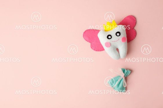 Cute toy for Tooth Fairy Day as funny smiling cartoon...