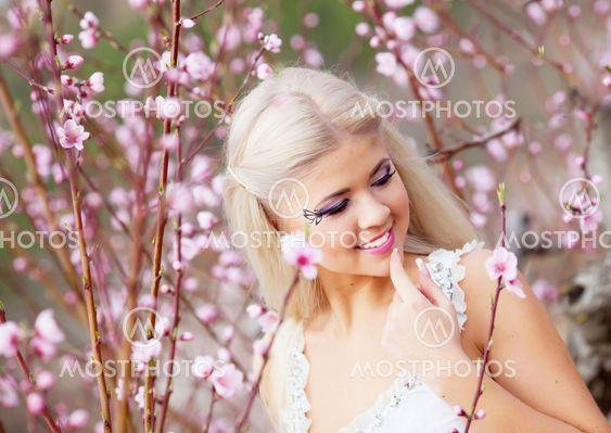 Girl in blossom garden