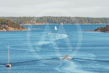 Boats trafficing the swedish archipelago outside of...