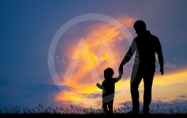 dad with his son at sunset