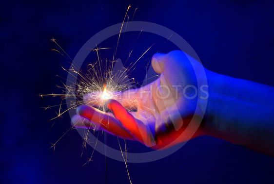 Hand Holding Fire Light Sparkler