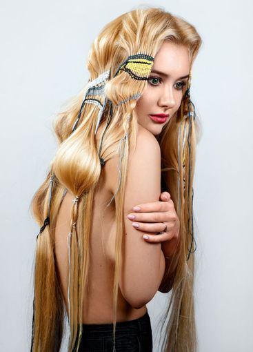 Beautiful blonde with long hair, unusual hairstyle with...