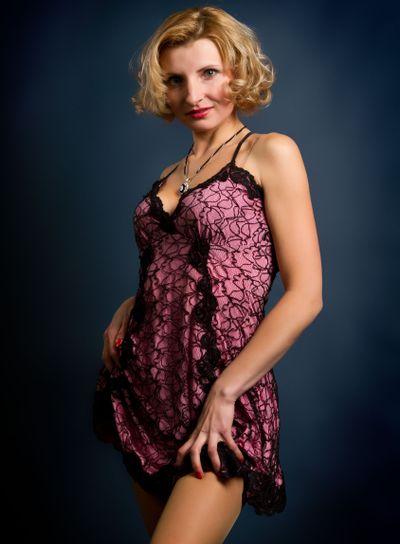 beautiful blonde girl on dark background