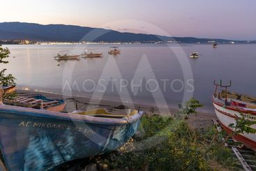 Sunset view of Coastal street of village of Stavros, Greece