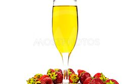 Glass of white wine and strawberries on a white background.