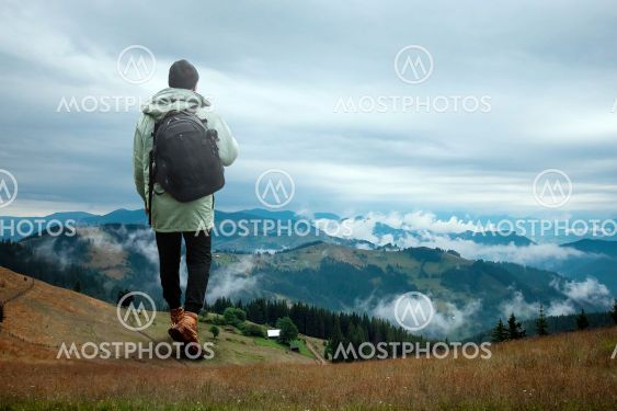 Creative background, A man is giant, a man is a tourist,...