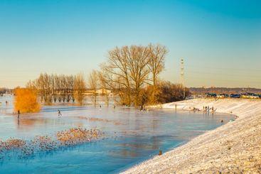 Ice skating on frozen floodplains in the Netherlands