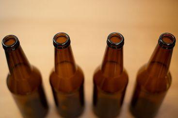Four dark empty beer bottles