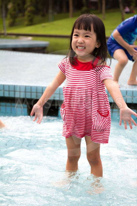 Chinese Little Girl Playing in Water