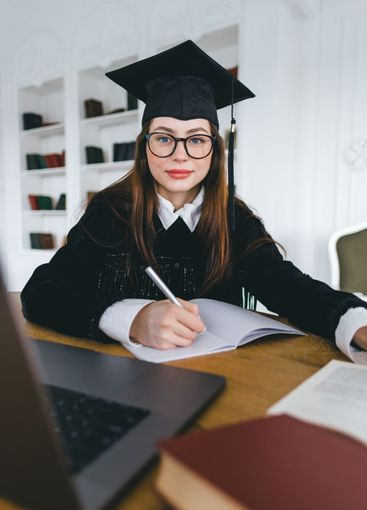 Portrait of young caucasian woman in eyeglasses college...