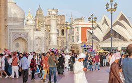 The crowded streets in the Global Village with mockups...