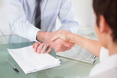 Office workers having a handshake