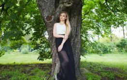 Adorable blonde woman posing in a park