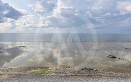 Stranden med molnspeglingar vid Neptuni åkrar på Öland