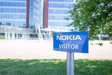 Visitor parking sign in front of Nokia Corporation office.
