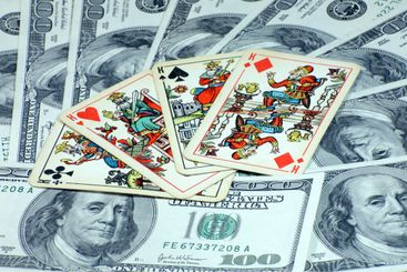 american dollars with playing cards