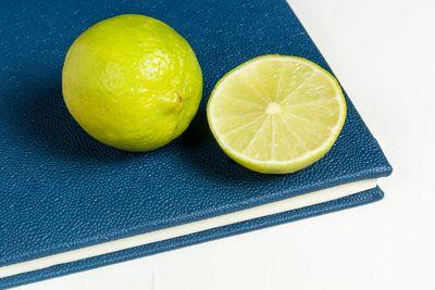 Slice of lemon on blue diary