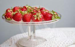 Fresh strawberries on glass plate