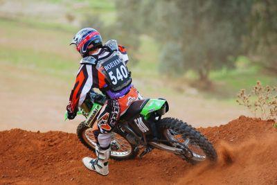 Motocross rider cornering