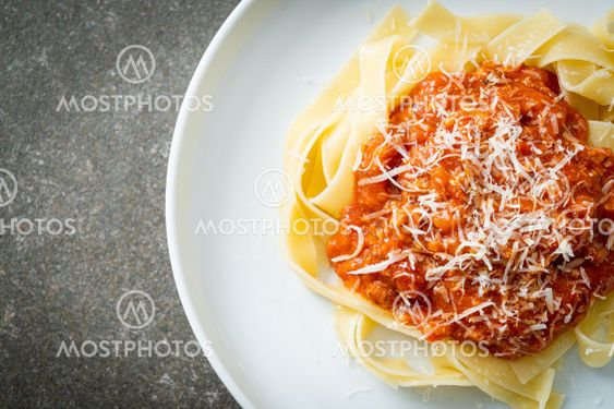 pork bolognese fettuccine pasta with parmesan cheese