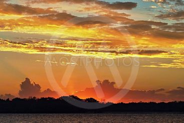 Sunset with high golden glow and crimson highliting and...
