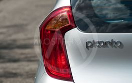 rear light on silver Kia picanto parked in the street