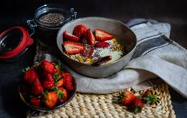 Healthy breakfast concept with oatmeal and strawberry