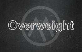 Healthcare concept: Overweight on chalkboard background
