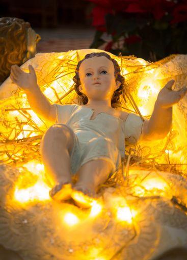 Baby Jesus vintage figurine in his crib.