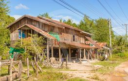 Typical house in the rural Laos at the bank of Mekong...